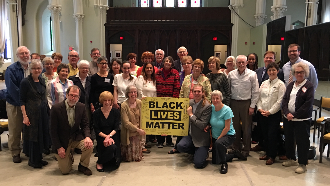 Congregation with BLM counter graffiti sign
